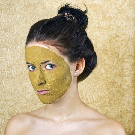 Green cosmetic mask on girl face Stock Photo - 17903932