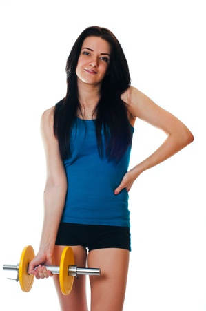 Young woman with a dumbell Stock Photo - 17903919