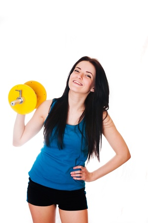 Happy Young woman with a dumbbell  Stock Photo - 17903912