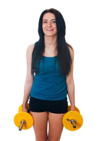 Young woman with a dumbbell  Stock Photo - 17903856