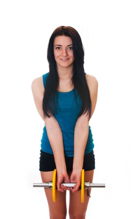 Young woman with a dumbbell  Stock Photo