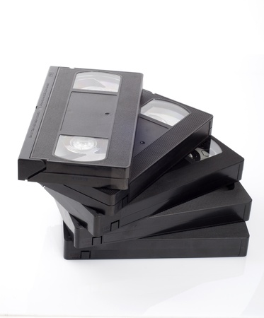 A stack of video cassettes isolated on white background