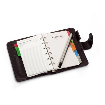 A diary opened at page of  Projects  with pen that hold on it  I Stock Photo