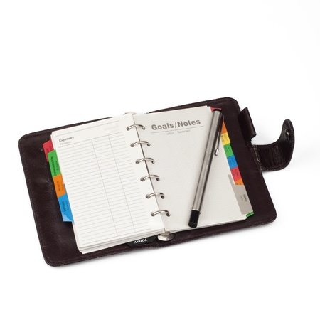 A diary opened at page of  Notes  with pen that lay on it  Isola Stock Photo - 17937171
