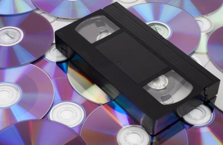 CD vs VHS  VHS cassette lay on the many CD disks