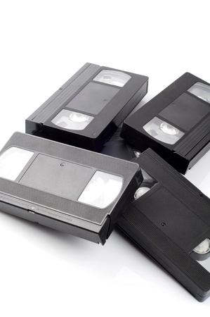 Pile of video cassettes isolated on white background