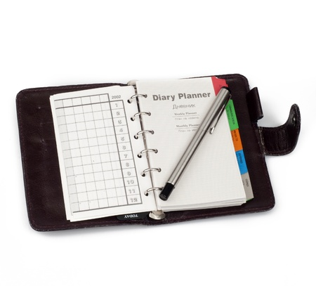 A diary opened at page of  Diary planner  with pen that lay on i Stock Photo - 17937192