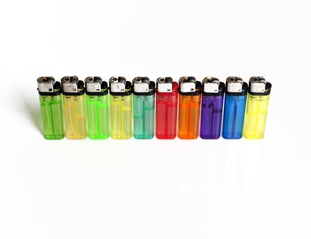 Many color lighters stand in line isolated on white background Stock Photo - 17937195