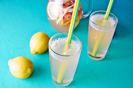 dring: Cold summer dring - lemonade in pitcher with lemons around it