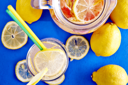 Ginger lemonade in glass with pithcer on back Stock Photo - 29677726