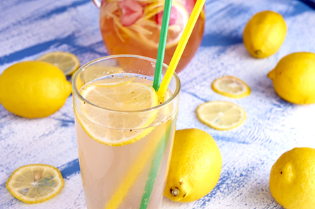 Pitcher of lemonade with lemons, and fresh photo