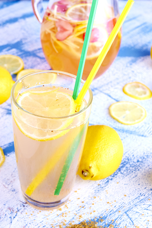 Ginger lemonade in glass with pithcer on back Stock Photo - 29677732