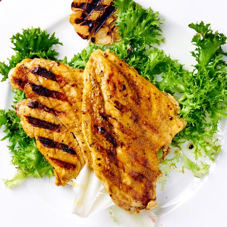 Grilled chicken breast with grilled garlic