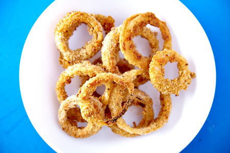 Top view of baked onion rings snack photo