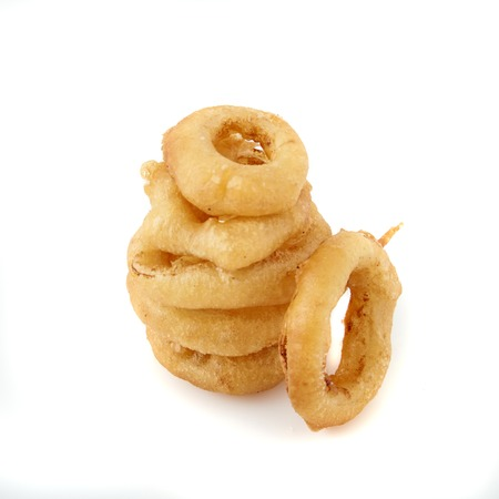 onion rings: Stack of freshly made crispy Golden onion rings. A wonderful, flavorful snack for beer or another beverage. Fastfood appetizer from the deep fryer. Isolated on white background close up shot.