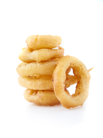 Stack of freshly made crispy Golden onion rings. A wonderful, flavorful snack for beer or another beverage. Fastfood appetizer from the deep fryer. Isolated on white background close up shot.