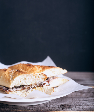 baguet: Baguet sandwich with beef and mayonnaise on wood background Stock Photo