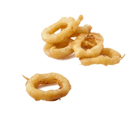 Stack of freshly made crispy Golden onion rings. Isolated on white background close up shot.