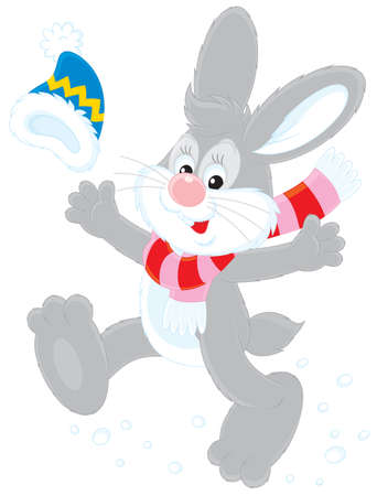 high spirits: cheerful grey rabbit wearing a cap and scarf