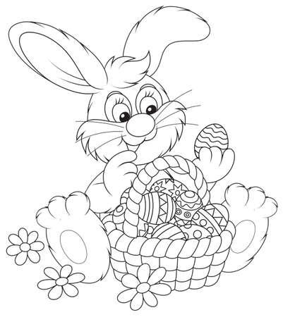 Conejo de Pascua, con una cesta de huevos pintados. Foto de archivo.