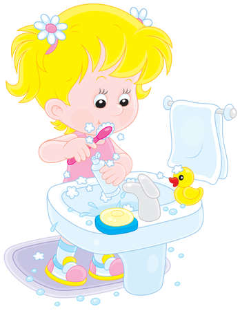Little girl cleaning teeth in a bathroom