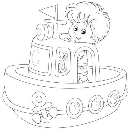 Little boy playing on board of a big toy ship