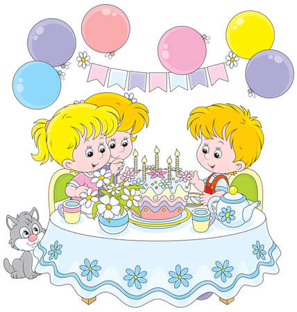 Children at the table with a birthday cake