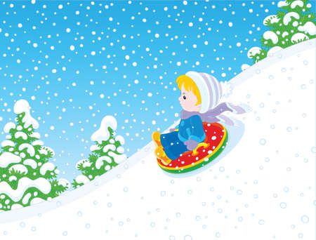 Child on a snow tube sliding down the snow hill