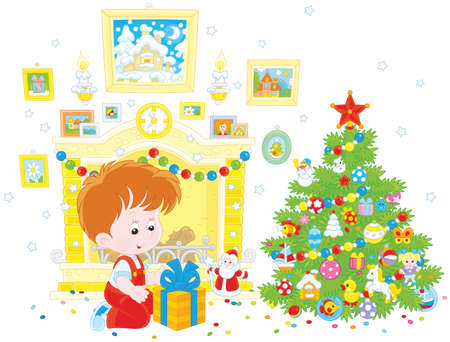 Little boy with his birthday gift Christmas tree
