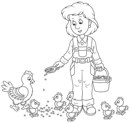 Smiling poultry woman feeding her hen and chicks