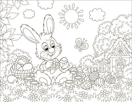 Little bunny painting Easter eggs on grass among flowers on its front lawn near a small hut with thatched roof on a sunny spring day, black and white vector illustration in a cartoon style