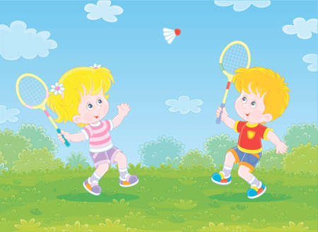 Happy little kids playing badminton with rackets and a flying shuttlecock in a fun game on a green playground in a summer park, vector cartoon illustration