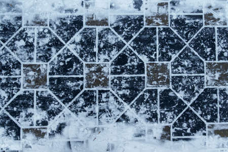 paving slabs under the snow