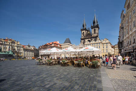czech women: Tourists visit the Old Town Square and Tyn Church of Prague