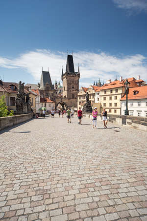 allover: Charles Bridge with Gothic architecture, the most popular spot in the city is visited by unidentified tourists from allover the world Editorial