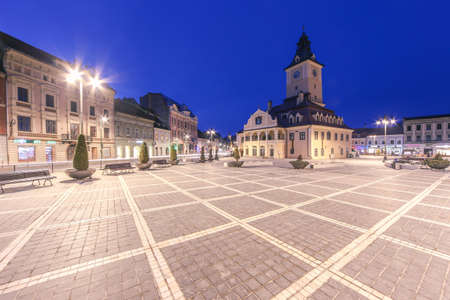 brasov: Brasov, Romania - March 5th, 2016: Twilight Shot of The Central Square on a spring Saturday evening.