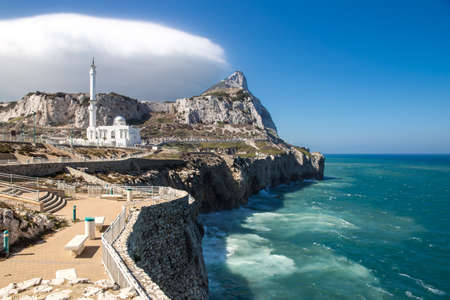 Europa Point with Ibrahim-al-Ibrahim Mosque and the profile of Gibraltar Rock. Stock Photo