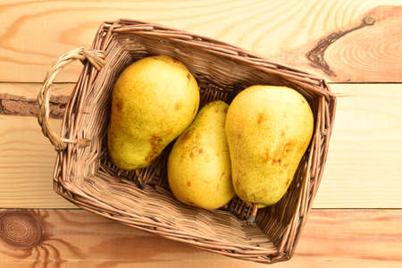 Ripe juicy, organic pears, close-up, on a wooden table.