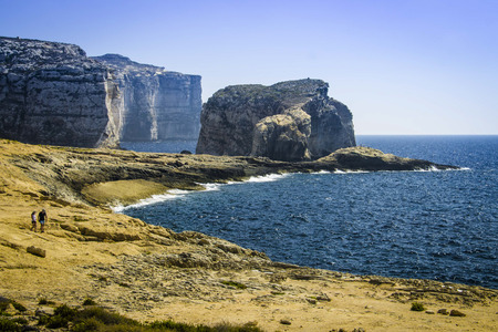 generals: Fungus Rock, colloquially known as the Generals Rock, is a 60 meters high islet at the entrance to the Dwajra Bay, on the coast of Gozo, Malta