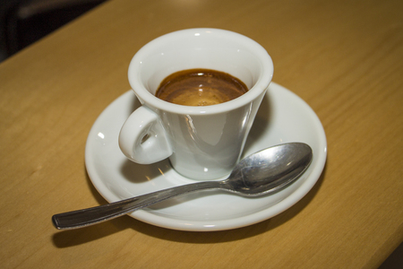 breackfast: italian espresso coffe cup with teaspoon