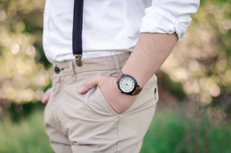 mans watch: Close up of a mans hand wearing a watch