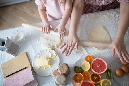 Mother And Daughter Making A Daugh For The Cookies Imagens