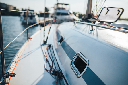 Yacht with the windows open on the pier with other boats Imagens