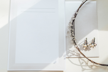 Wedding decorations and invitations on white table