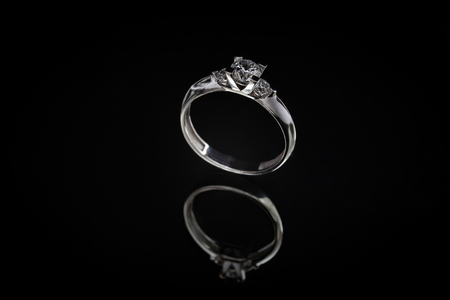 White gold ring on a black background