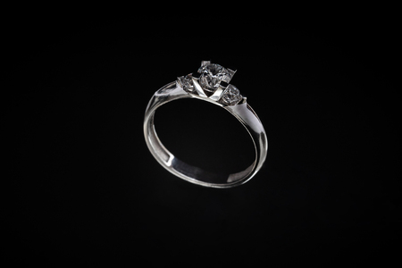 White gold ring with a precious stone inside