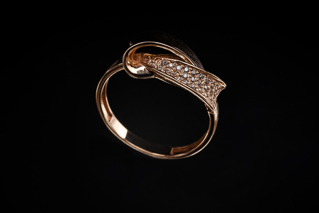 Precious gold ring with stones and reflection on glass Imagens