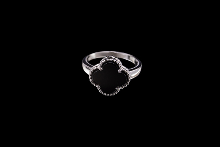 Silver ring with a stone inside on a black background