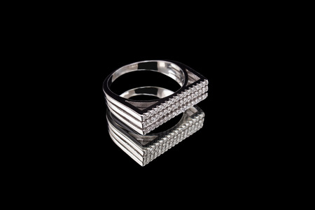 White gold ring with a precious stone