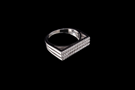 Silver ring on a black background. Macro shooting Imagens